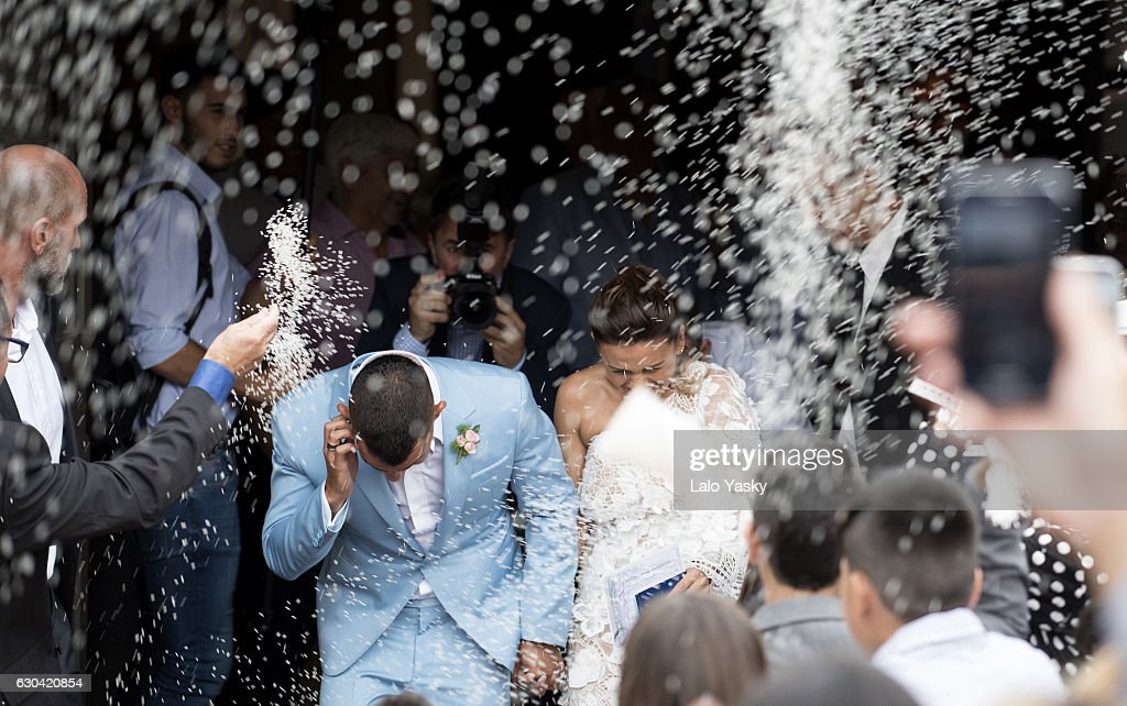 Carlos Tevez and Vanesa Mansilla leave the San Isidro City Hall after their civil wedding ceremony on December 22, 2016 in Buenos Aires, Argentina.