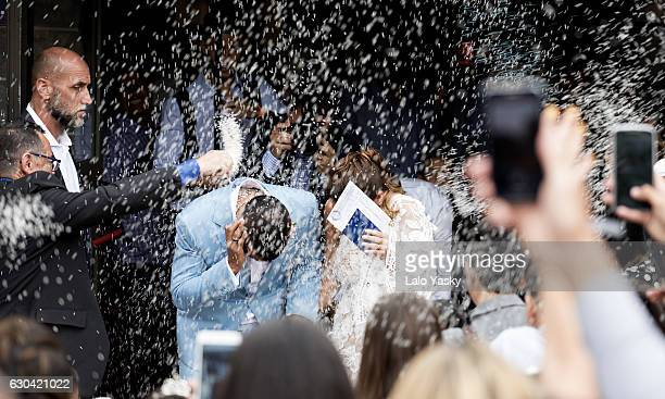 Carlos Tevez and Vanesa Mansilla leave the San Isidro City Hall after their civil wedding ceremony on December 22 2016 in Buenos Aires Argentina