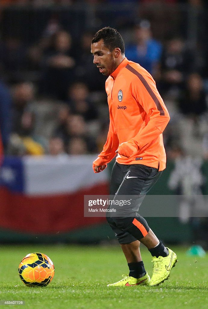 Carlos Tevez controls the ball during a Juventus training session at WIN Jubilee Stadium on August 9, 2014 in Sydney, Australia.