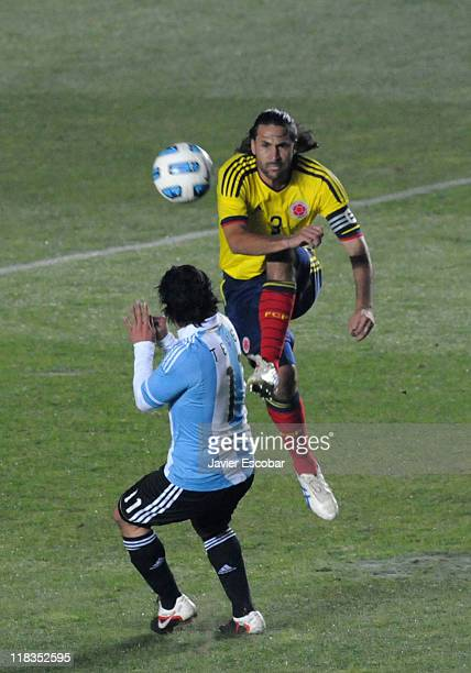 Carlos Tevez from Argentina fghts for the ball against Abel Aguilar from Colombia during a match between Argentina and Colombia as part of the group...