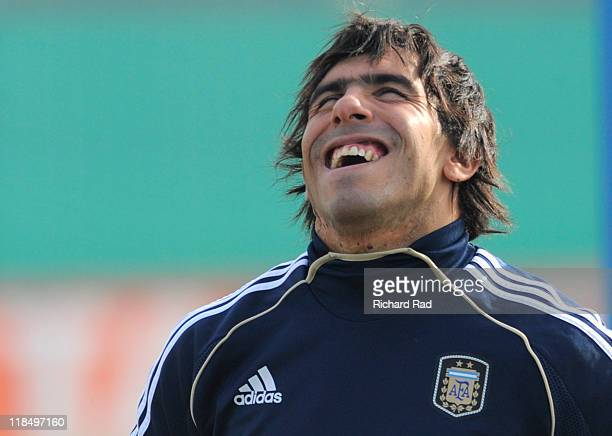 Carlos Tevez gestures after a training session at the Asociacion Argentina de Futbol facilities on July 08 2011 in Buenos Aires Argentina The...