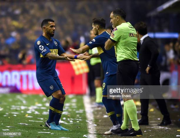 Carlos Tevez greets Mauro Zarate of Boca Juniors after being replaced during a match between Boca Juniors and River Plate as part of Superliga...