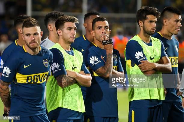 Carlos Tevez Julio Buffarini of Boca Juniors look dejected after losing the Supercopa Argentina 2018 against River Plate at Malvinas Argentinas...