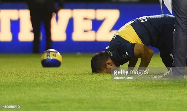 Carlos Tevez kisses the field during his presentation as new player of Boca Juniors at Alberto J Armando Stadium on July 13 2015 in Buenos Aires...