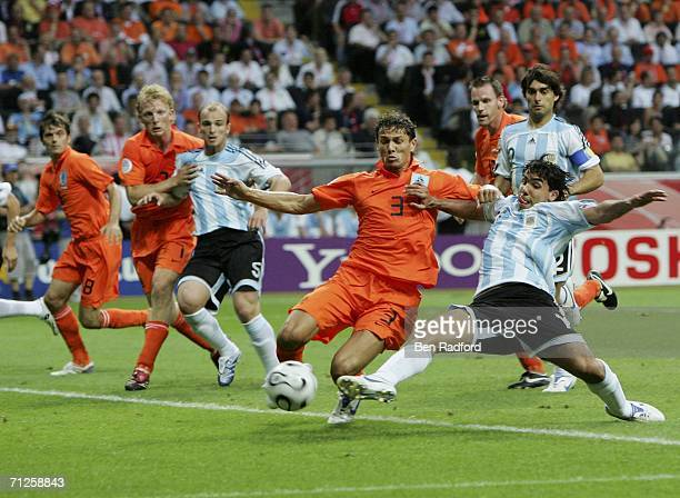 Carlos Tevez of Argentina attempts a shot on goal as Khalid Boulahrouz of the Netherlands closes in during the FIFA World Cup Germany 2006 Group C...