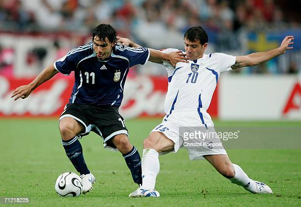 Carlos Tevez of Argentina battles with Dejan Stankovic of Serbia Montenegro during the FIFA World Cup Germany 2006 Group C match between Argentina...