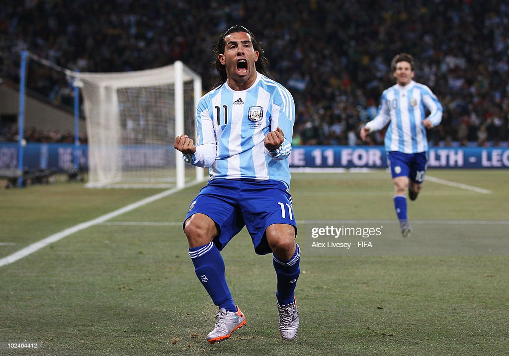 Carlos Tevez of Argentina celebrates scoring during the 2010 FIFA World Cup South Africa Round of Sixteen match between Argentina and Mexico at Soccer City Stadium on June 27, 2010 in Johannesburg, South Africa.
