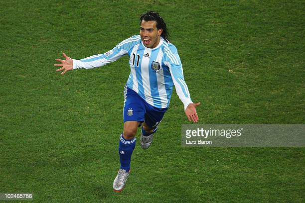 Carlos Tevez of Argentina celebrates scoring the third goal for his team during the 2010 FIFA World Cup South Africa Round of Sixteen match between...
