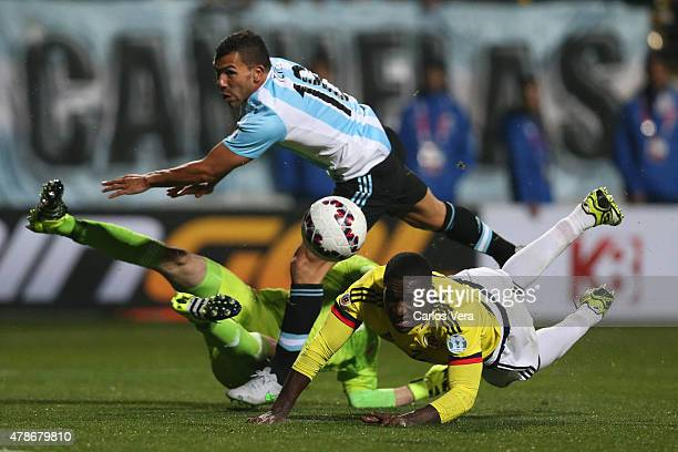 Carlos Tevez of Argentina clashes with David Ospina of Colombia during the 2015 Copa America Chile quarter final match between Argentina and Colombia...