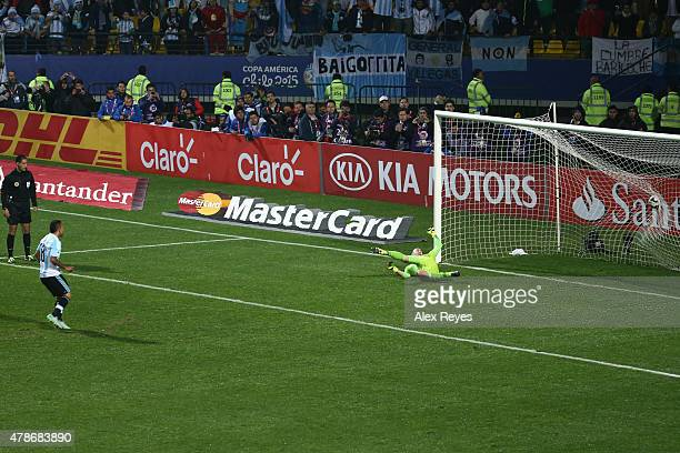 Carlos Tevez of Argentina converts the seventh penalty kick in the penalty shootout during the 2015 Copa America Chile quarter final match between...