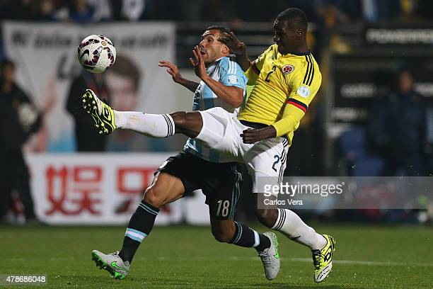 Carlos Tevez of Argentina fights for the ball with Cristian Zapata of Colombia during the 2015 Copa America Chile quarter final match between...