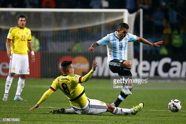 Carlos Tevez of Argentina fights for the ball with Edwin Cardona of Colombia during the 2015 Copa America Chile quarter final match between Argentina...