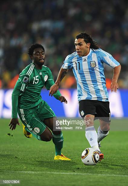 Carlos Tevez of Argentina is chased by Ayodele Adeleye of Nigeria during the 2010 FIFA World Cup South Africa Group B match between Argentina and...