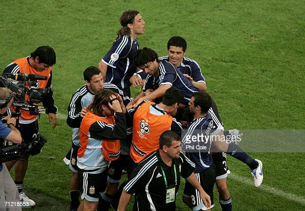 Carlos Tevez of Argentina is congratulated by the rest of the squad after he scored the sixth goal during the FIFA World Cup Germany 2006 Group C...