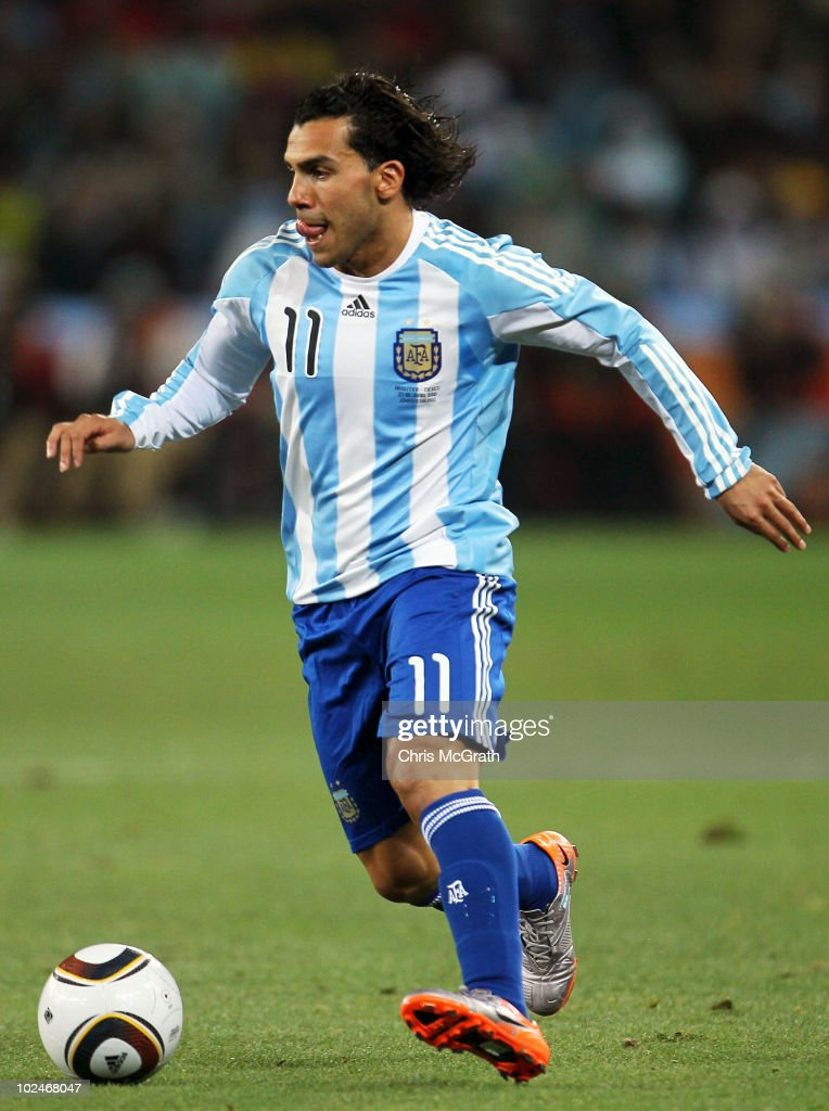 Carlos Tevez of Argentina runs with the ball during the 2010 FIFA World Cup South Africa Round of Sixteen match between Argentina and Mexico at Soccer City Stadium on June 27, 2010 in Johannesburg, South Africa.