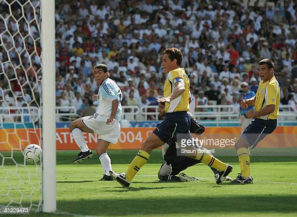 Carlos Tevez of Argentina scores the first goal during in the men's football gold medal match between Argentina and Paraguay on August 28, 2004...