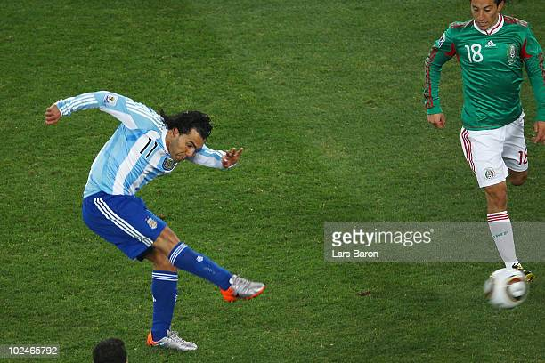 Carlos Tevez of Argentina scores the third goal for his team during the 2010 FIFA World Cup South Africa Round of Sixteen match between Argentina and...