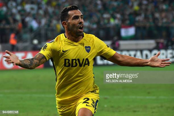 Carlos Tevez of Argentina's Boca Juniors celebrates after scoring a goal against Brazil's Palmeiras during a 2018 Copa Libertadores football match at...