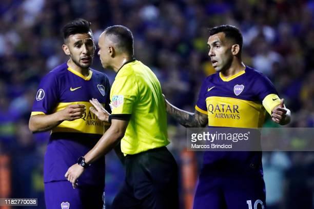Carlos Tevez of Boca Juniors and Eduardo Salvio of Boca Juniors argue with Referee Wilton Sampaio after a disallowed goal during the Semifinal second...