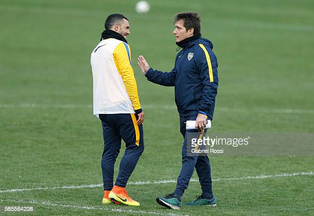 Carlos Tevez of Boca Juniors and Guillermo Barros Schelotto talk during a Boca Juniors Training Session at Alberto J Armando Stadium on August 02...