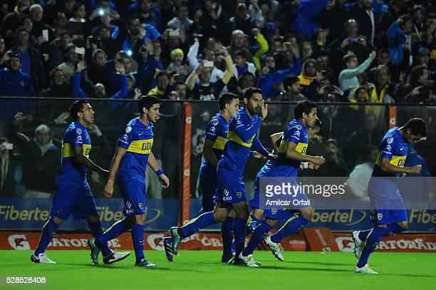 Carlos Tevez of Boca Juniors and his teammates celebrate the first goal of their team during a second leg match between Boca Juniors and Cerro...