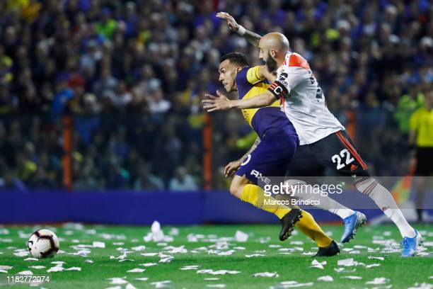 Carlos Tevez of Boca Juniors and Javier Pinola of River Plate fight for the ball during the Semifinal second leg match between Boca Juniors and River...