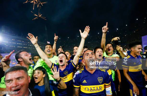 Carlos Tevez of Boca Juniors and teammates celebrate winning the championship after a match between Boca Juniors and Gimnasia y Esgrima La Plata as...