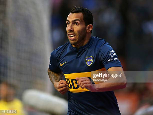 Carlos Tevez of Boca Juniors celebrates after forcing an own goal by Gabriel Tomassini of Crucero del Norte during a match between Boca Juniors and...