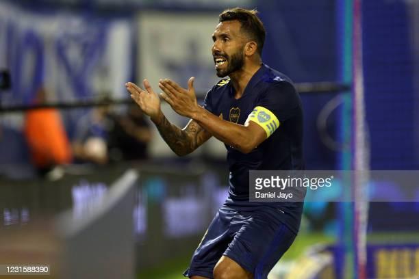 Carlos Tevez of Boca Juniors celebrates after scoring his team's fifth goal during a match between Velez Sarsfield and Boca Juniors as part of Copa...