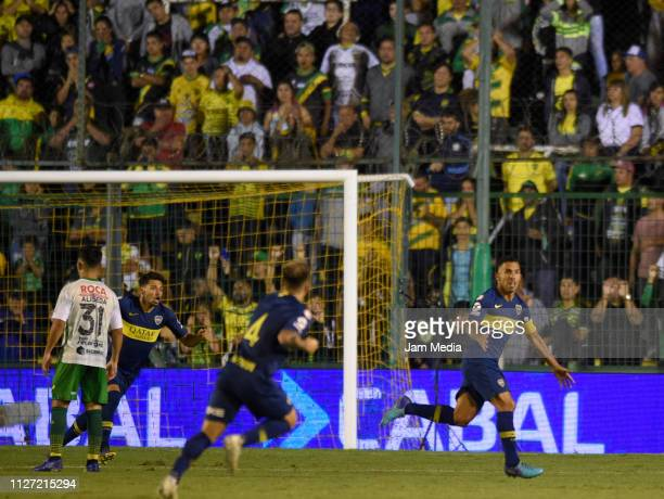 Carlos Tevez of Boca Juniors celebrates after scoring the first goal of his team during a match between Defensa y Justicia and Boca Juniors as part...