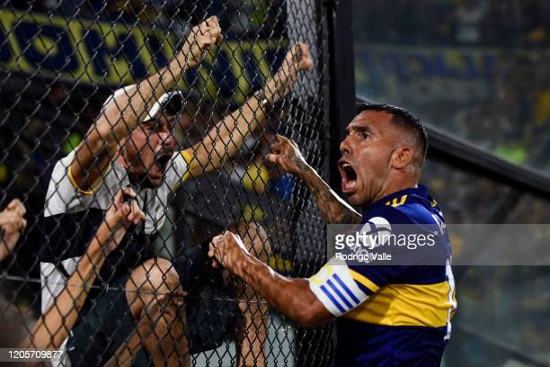Carlos Tevez of Boca Juniors celebrates after scoring the first goal of his team with fans during a match between Boca Juniors and Gimnasia as part...