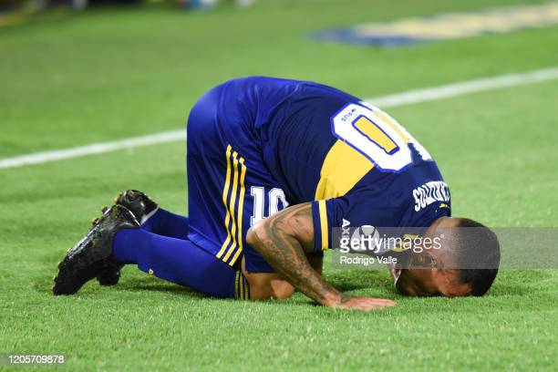 Carlos Tevez of Boca Juniors celebrates after scoring the first goal of his team as he kisses the pitch during a match between Boca Juniors and...