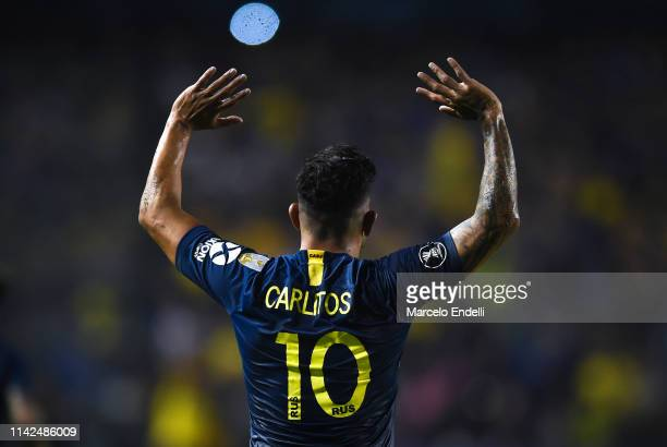 Carlos Tevez of Boca Juniors celebrates after scoring the second goal of his team during a group G match between Boca Juniors and Atletico Paranaense...