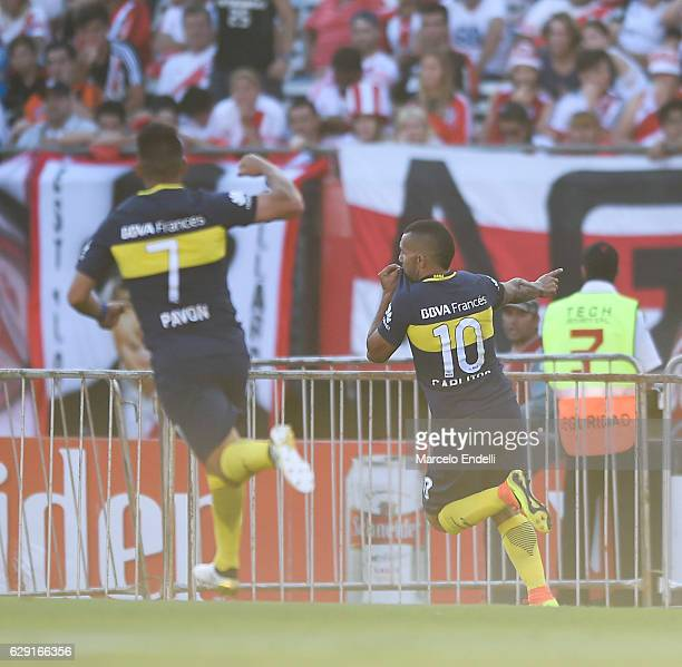 Carlos Tevez of Boca Juniors celebrates after scoring the third goal of his team during a match between River Plate and Boca Juniors as part of...