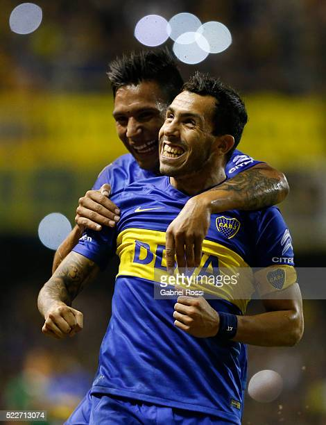 Carlos Tevez of Boca Juniors celebrates with Andres Chavez after scoring the fourth goal of his team during a match between Boca Juniors and...