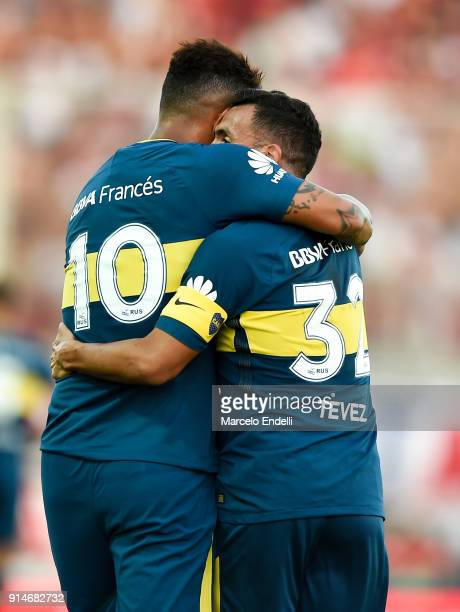 Carlos Tevez of Boca Juniors celebrates with Edwin Cardona of Boca Juniors after scoring the first goal of his team during a match between San...