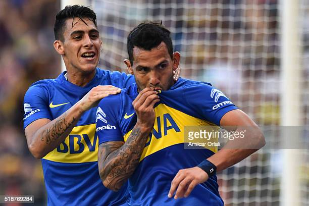 Carlos Tevez of Boca Juniors celebrates with his teammate after scoring the first goal of his team during a match between Boca Juniors and Atletico...