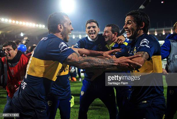 Carlos Tevez of Boca Juniors celebrates with his teammate Marcelo Meli after winning a final match between Boca Juniors and Rosario Central as part...