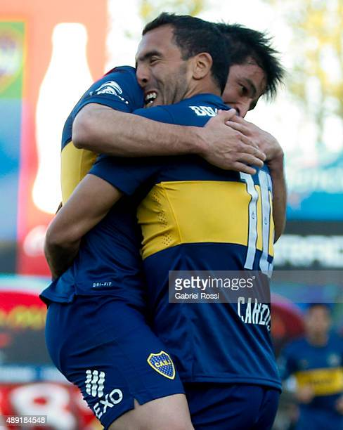 Carlos Tevez of Boca Juniors celebrates with Nicolás Lodeiro after scoring his team's second goal during a match between Argentinos Juniors and Boca...