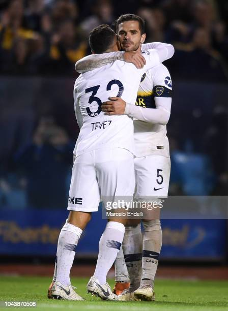 Carlos Tevez of Boca Juniors celebrates with teammate Fernando Gago after scoring the third goal of his team during a match between Boca Juniors and...