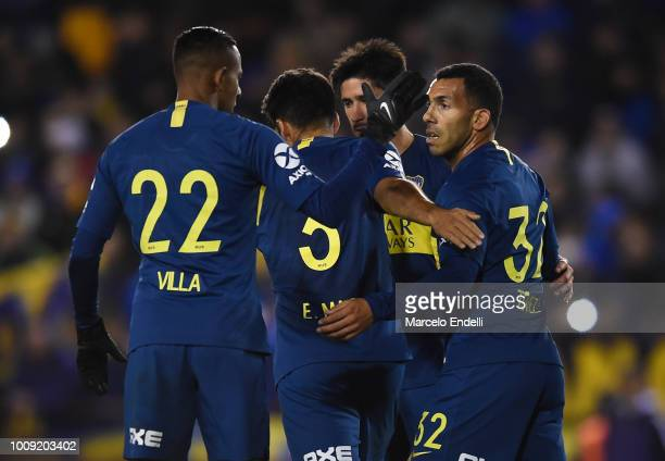 Carlos Tevez of Boca Juniors celebrates with teammates after scoring the sixth goal of his team during a match between Boca Juniors and Alvarado as...