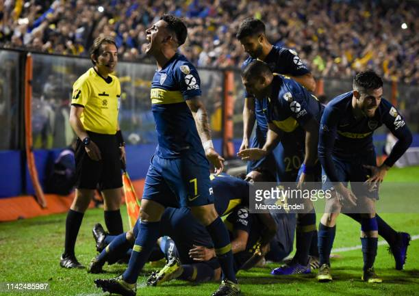 Carlos Tevez of Boca Juniors celebrates with teammates after scoring the second goal of his team during a group G match between Boca Juniors and...