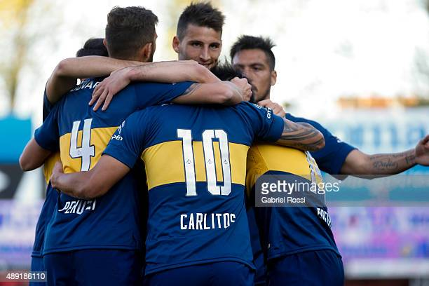 Carlos Tevez of Boca Juniors celebrates with teammates after scoring his team's second goal during a match between Argentinos Juniors and Boca...