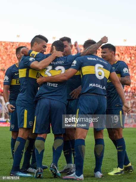 Carlos Tevez of Boca Juniors celebrates with teammates after scoring the first goal of his team during a match between San Lorenzo and Boca Juniors...
