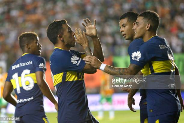 Carlos Tevez of Boca Juniors celebrates with teammates after scoring the first goal of his team during a match between Banfield and Boca Juniors as...