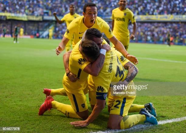 Carlos Tevez of Boca Juniors celebrates with teammates after scoring the first goal of his team during a match between Boca Juniors and San Martin de...