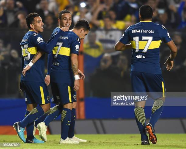 Carlos Tevez of Boca Juniors celebrates with teammates after scoring the fifth goal of his team during a match between Boca Juniors and Alianza Lima...