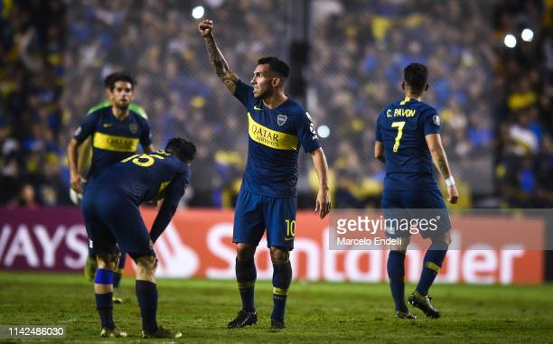 Carlos Tevez of Boca Juniors celebrates with teammates after winning a group G match between Boca Juniors and Atletico Paranaense as part of Copa...
