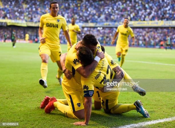 Carlos Tevez of Boca Juniors celebrates with teammates Cristian Pavon Nahitan Nandez and Leonardo Jara after scoring the first goal of his team...
