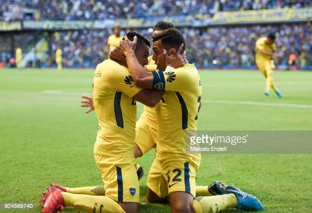 Carlos Tevez of Boca Juniors celebrates with teammates Cristian Pavon and Nahitan Nandez after scoring the first goal of his team during a match...